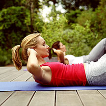 Woman doing crunches outside